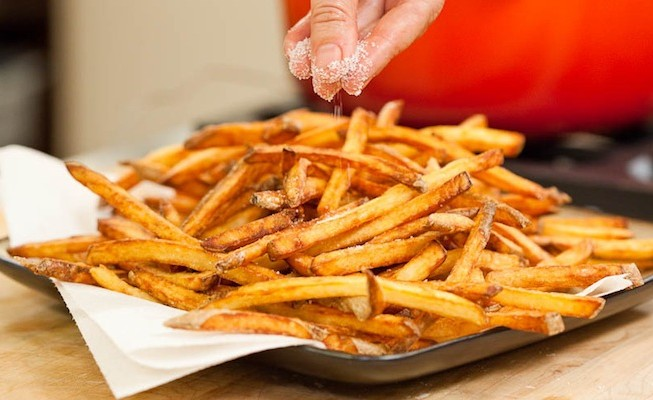 Season fries with salt and serve immediately.