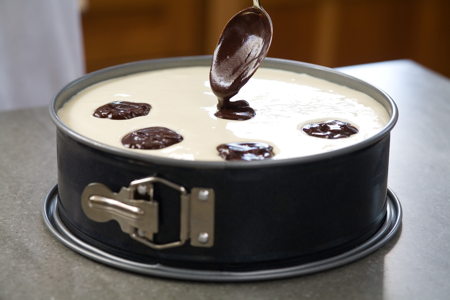 Drop spoonfuls of the chocolate randomly over the top of the batter ...